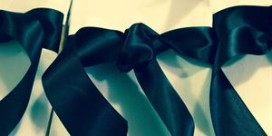 Hire - white linen napkin with matching ribbon